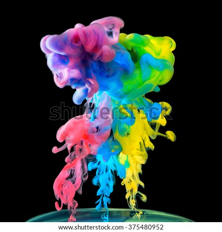 Colored inks in water on black background - stock photo