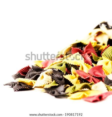 Colored Italian Pasta  isolated on white background close up.  Fresh Bow tie pasta isolated on white background.  - stock photo