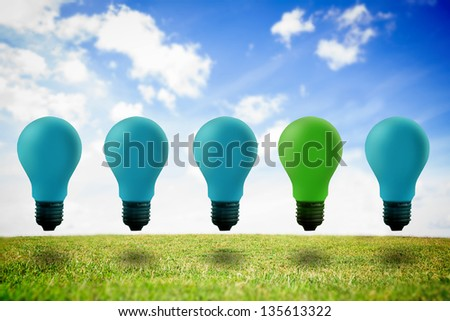 Colored light bulbs against sky background