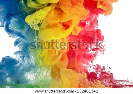 Colored liquids are mixed in traffic-red, yellow, blue - stock photo