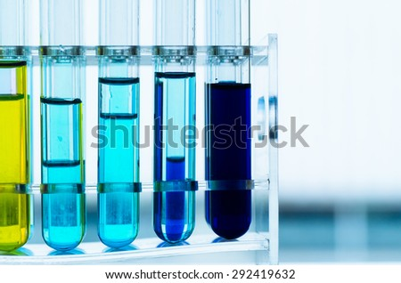 Colored liquids in  test tubes isolated over white background
