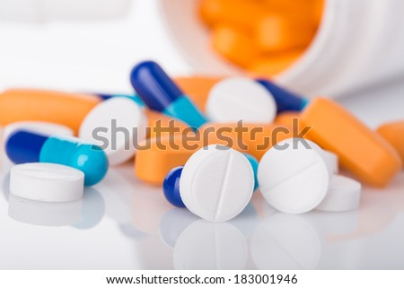 colored medical pills on white background - stock photo