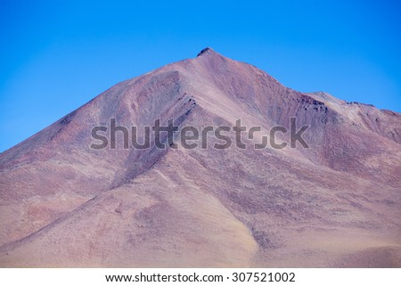 Colored mountains in the Atacama desert with blue sky in Eduardo Avaroa Andean Fauna National Reserve, Bolivia - stock photo