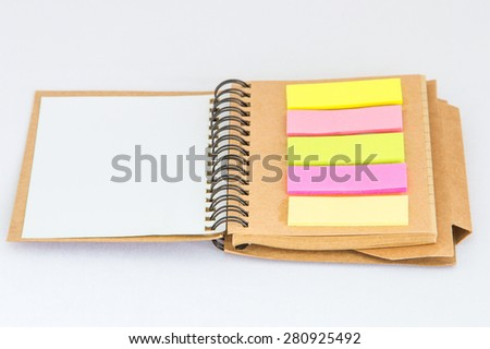 colored note/memo blank with notebook - stock photo