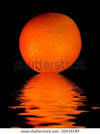 colored orange -  on black with reflection in water - stock photo