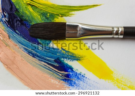 colored paints and brushes for painting on canvas and paper - stock photo
