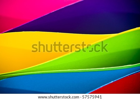 Colored paper background stacked in wedges - stock photo