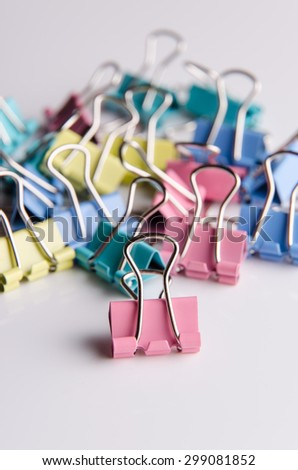 Colored paper clips for office usage. - stock photo