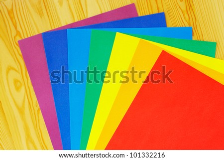 Colored paper is how the Rainbow colours on wooden