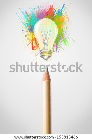 Colored pencil close-up with colored paint splashes and lightbulb concept - stock photo