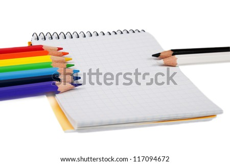 Colored pencils against black and white pensils isolated on white - stock photo
