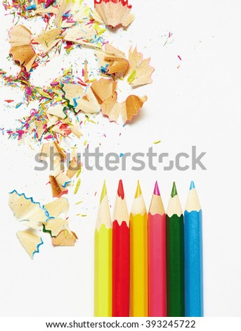 Colored pencils and sharpening trash. Close up view - stock photo