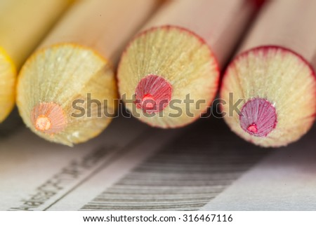 Colored pencils close up -Colored pencils close up front view - Colored pencils macro shot - stock photo