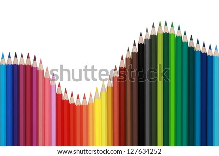 Colored pencils forming a diagram with the shape of a wave - stock photo