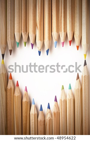Colored pencils heart shape - stock photo