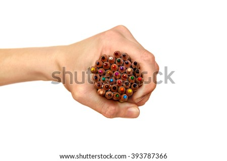 Colored pencils in a female hand isolated on white - stock photo
