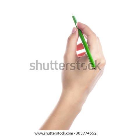 Colored pencils in a female hand on a white background .