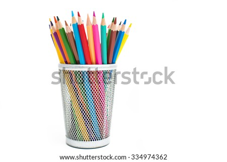 Colored pencils in a pencil case on white background - stock photo