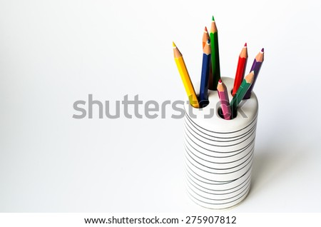 Colored pencils in the glass on white background , business,education,Learn,art, concept  - stock photo