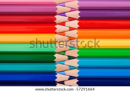 Colored pencils in zigzag position - stock photo