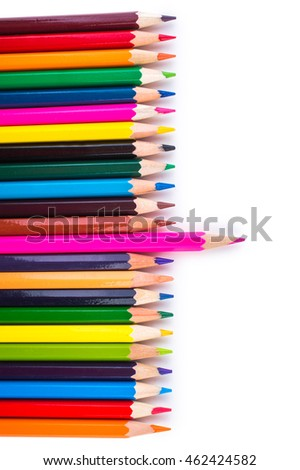 Colored pencils isolated on a white background closeup