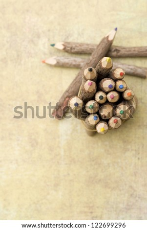 colored pencils on textured background - stock photo