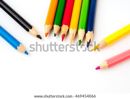 Colored pencils on white background. Stationery