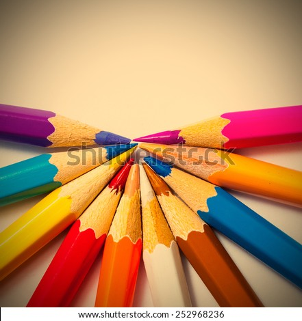 colored pencils on white background with copy space. instagram image retro style - stock photo