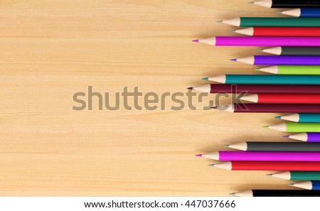 Colored pencils on wooden signboard with copy space for background, educational signboard background with copy space concept, 3D rendering