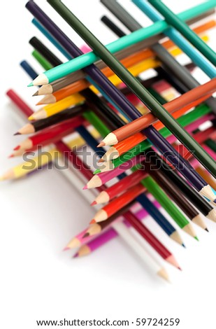 Colored pencils tower on white background. - stock photo