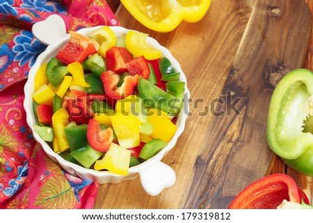 Colored Peppers mixed and  chopped up. Colorful diced peppers in a bowl . Cooking At Home. Prepare Food. Macro, selective focus. - stock photo