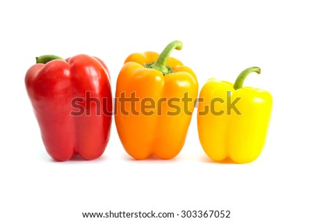 colored peppers over white background - stock photo