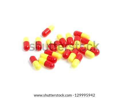 Colored pills on a white background