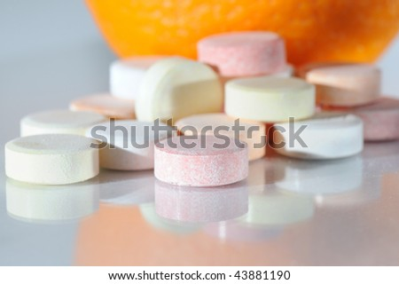 Colored pills with orange close up