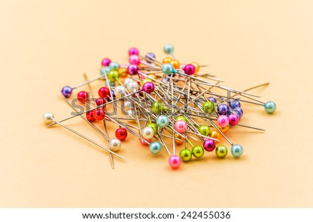 Colored pins on yellow table. - stock photo