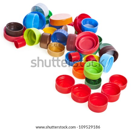 Colored plastic bottle caps  isolated on white - stock photo