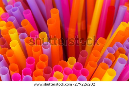 Colored plastic drinking straws holes background. - stock photo