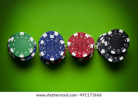Colored poker chips on green table