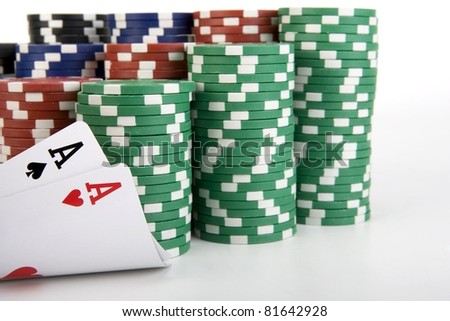 Colored Poker Chips with a Pair of Ace's - stock photo