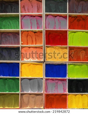 Colored powder dyes are sold on the market in Bhaktapur - Nepal - stock photo
