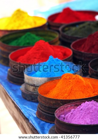 Colored powders at market in Pisac, Peru - stock photo