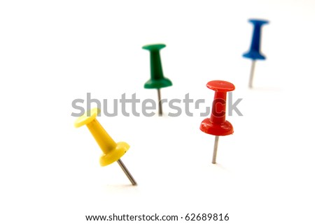 colored push pins isolated on white - stock photo