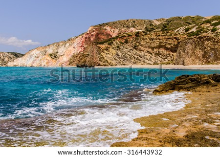 Colored rocks on Fyriplaka beach, Milos island, Cyclades, Greece.