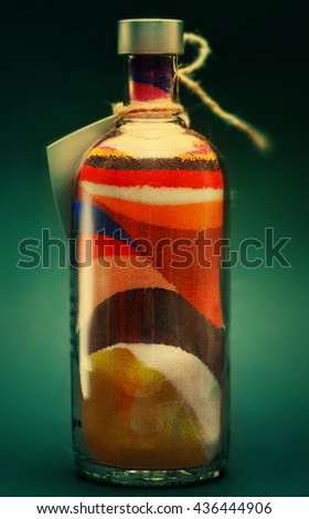 Colored sand poured in layers in a bottle - stock photo