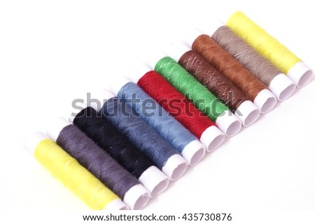 Colored sewing threads isolate on white background -select focus - stock photo