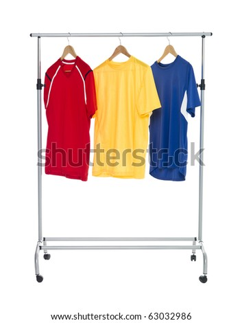 Colored shirts on a Clothes Rack isolated on white background - stock photo