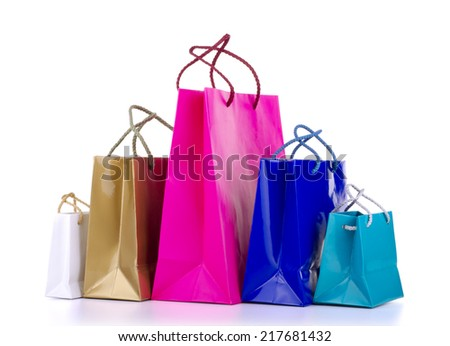 Colored shopping bags on a white background. - stock photo