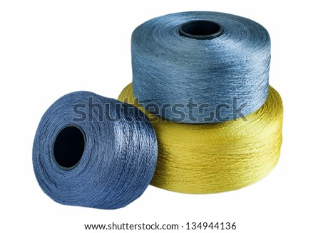 Colored silk yarn rolled on coils isolated on white background