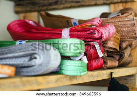 Colored slings operating procedures for heavy loads are on the rack - stock photo
