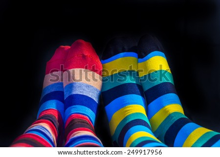 Colored socks on a Valentine couple feets - stock photo